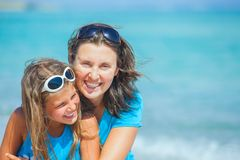 Mother and her daughter having fun on beach Stock Photography