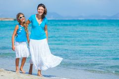 Mother and her daughter having fun on beach Stock Photo