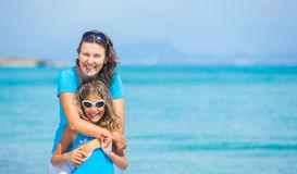 Mother and her daughter having fun on beach Royalty Free Stock Photos