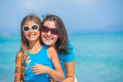 Mother and her daughter having fun on beach Royalty Free Stock Image