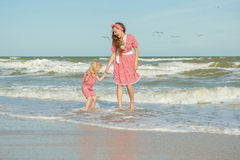 Mother and her daughter  having fun on the beach Stock Photo