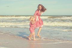 Mother and her daughter  having fun on the beach Royalty Free Stock Photography