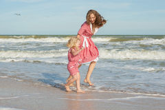 Mother and her daughter  having fun on the beach Royalty Free Stock Photos