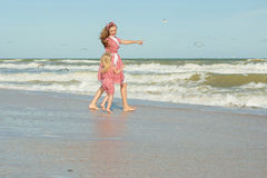 Mother and her daughter  having fun on the beach Stock Images