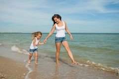 Mother and her daughter  having fun on the beach Royalty Free Stock Images