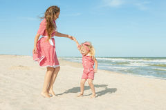 Mother and her daughter  having fun on the beach Stock Photography