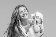 Mother and her daughter having fun Stock Images