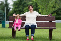 Mother and Her Daughter having Fun Outside on the Bench Stock Images