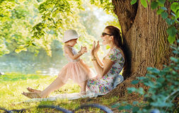 Mother and her daughter having fun in park Royalty Free Stock Photo