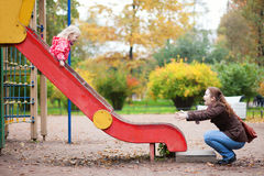 Mother and her daughter are having fun together Stock Photos