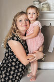 Mother with her daughter in her arms Royalty Free Stock Images