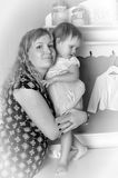 Mother with her daughter in her arms Royalty Free Stock Photo