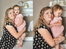 Mother with her daughter in her arms Stock Photography