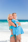 Mother with her daughter in her towel Royalty Free Stock Photos
