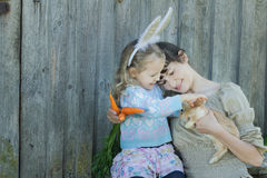 Mother and her daughter holding adorable little Easter rabbit Stock Image