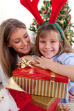 Mother and her daughter holding Christmas gifts Royalty Free Stock Images