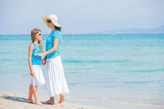 Mother and her daughter holding hands on the beach Stock Photo