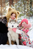 Mother and her daughter hugging Huskies Stock Photography