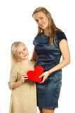 Mother and her daughter keeps heart Stock Photos