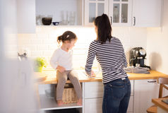 Mother with her daughter in the kitchen cooking together Stock Photo