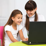 Mother an her daughter with laptop Royalty Free Stock Photo