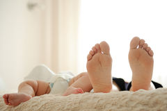 Feet on Bed Royalty Free Stock Photos
