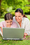 Mother and her daughter looking at their laptop Stock Photography