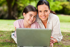 Mother and her daughter looking at their laptop Royalty Free Stock Photo