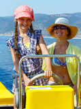 Mother with her daughter in a motorboat. Royalty Free Stock Photos