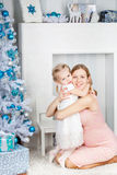 Mother and her daughter near christmas tree Royalty Free Stock Images
