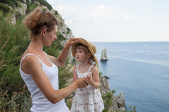 Mother and her daughter near the seashore Stock Photography