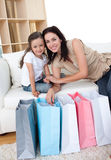 Mother and her daughter opening shopping bags Royalty Free Stock Photography