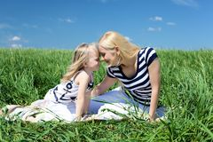 Mother with her daughter outdoors Stock Photography