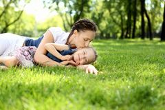Mother with her daughter outside Stock Photo