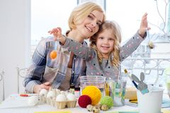 Mother and her daughter painting and decorating easter eggs. Stock Photos