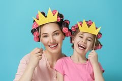 Mother and her daughter with a paper accessories Royalty Free Stock Images