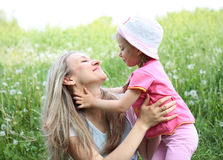 Mother and her daughter in the park on  sunny  day Stock Image