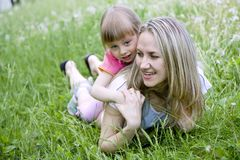 Mother and her daughter in the park on  sunny  day Stock Photography