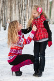 Mother and her daughter in park in winter Stock Photo