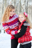 Mother and her daughter in park in winter Stock Images