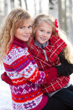 Mother and her daughter in park in winter Royalty Free Stock Photography