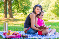 Mother with her daughter at a picnic Stock Photography