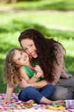 Mother and her daughter picnicking Stock Image