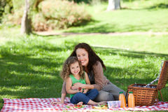 Mother and her daughter picnicking. Joyful mother and her daughter picnicking Stock Photography