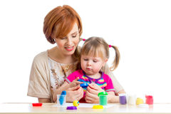 Mother and her daughter play with dough. Mother and daughter play with dough Royalty Free Stock Photos