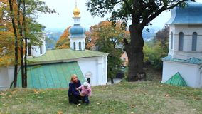 Mother with her daughter play in the monastery stock video