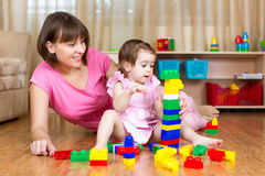 Mother and her daughter play toys Stock Photos