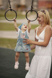 Mother with daughter on playground Stock Photography