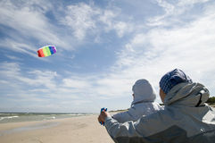Mother with her daughter playing with kite Royalty Free Stock Image