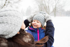 Mother with her daughter playing outside in winter nature Stock Photography